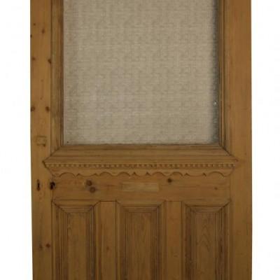 A large Victorian pine front door