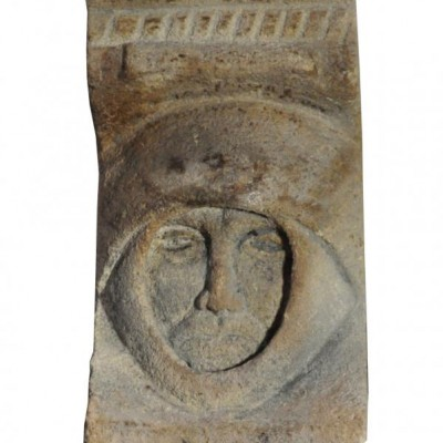 A carved stone corbel, in the form of a mediaeval head