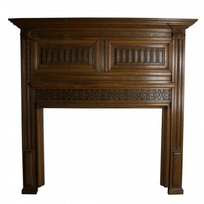 A large Victorian carved oak fire surround