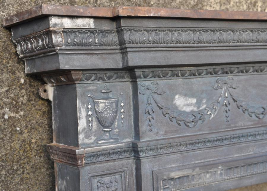 19th century  break fronted cast iron fire surround