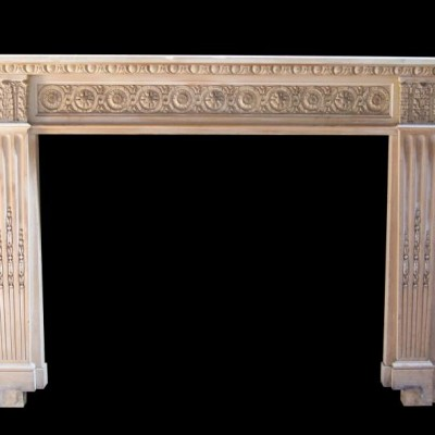 A French style timber and gesso fire surround