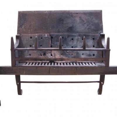 A Georgian wrought iron fire grate