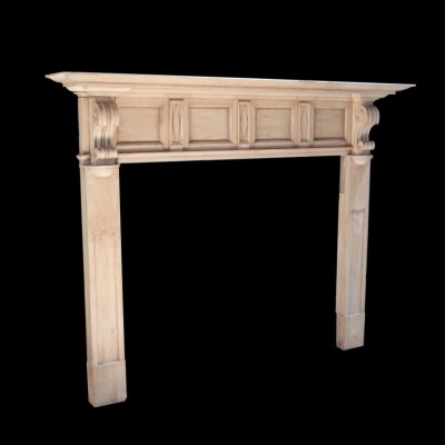 A 19th century carved pine fire surround with carved corbels and frieze