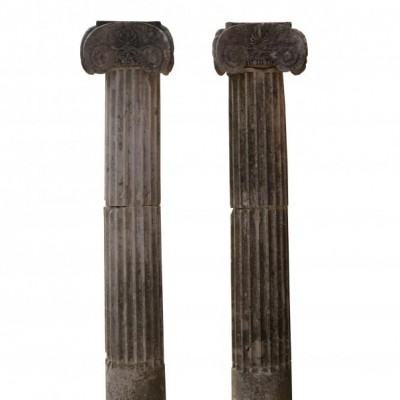 A pair of carved Portland stone Ionic order fluted half column section pilasters
