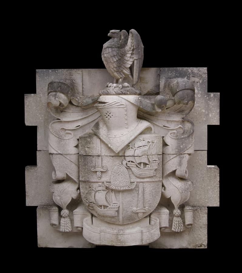 A late 19th century carved Portland stone armorial crest / plaque