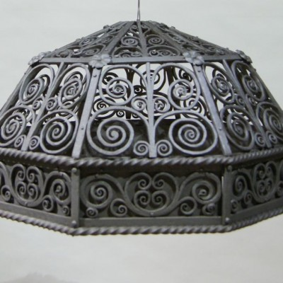 An ornate wrought iron lamp shade