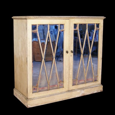 A 19th century mirror fronted cabinet