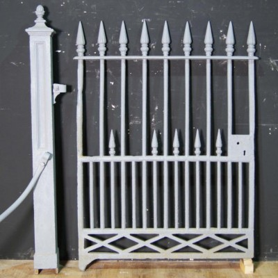 An early 19th century cast iron gate and post