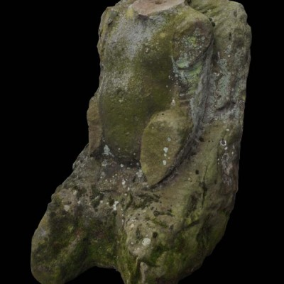 An 18th century carved sandstone torso / lamp base