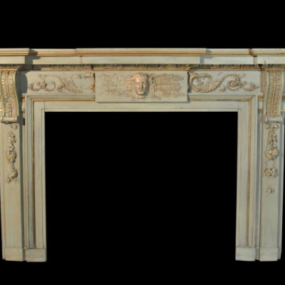 A Large early 19th century painted wooden fire surround