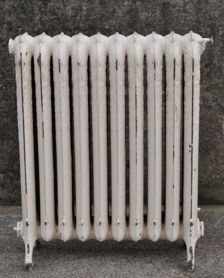 antique decorative princess cast iron radiator.