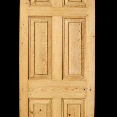 A Georgian stripped pine arched door