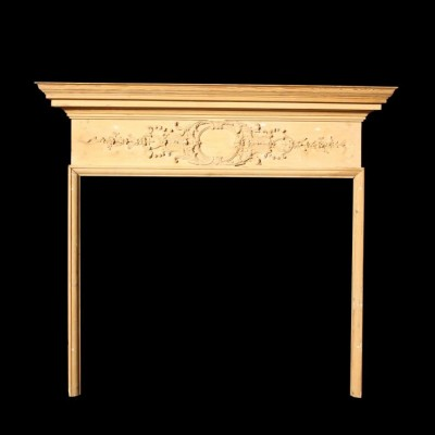 An early 19th century carved fire surround