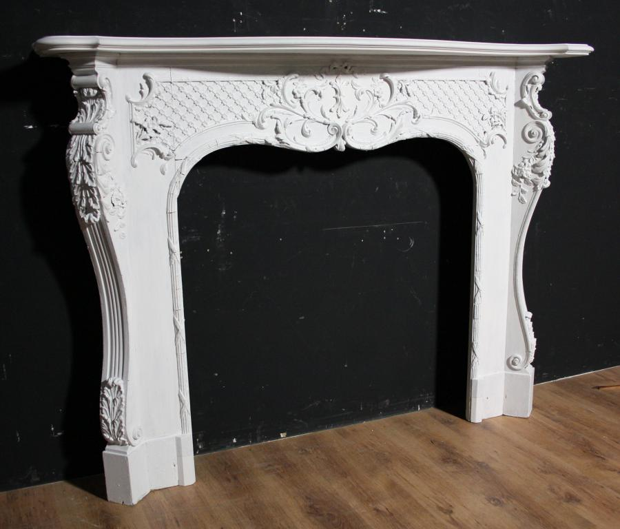 A late 19th century French Rococo style fire surround