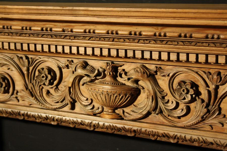 A Georgian carved pine fire surround / Chimneypiece