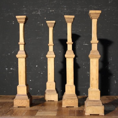 A set of four early 20th C. wooden candle sticks / holders