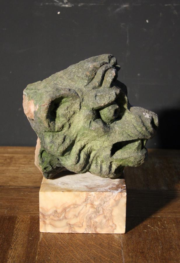 A 19th century carved sandstone grotesque head