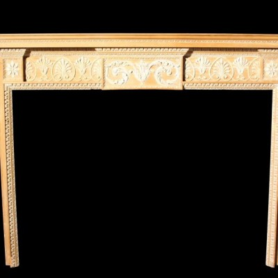 A fine quality carved pine and lime wood fire surround