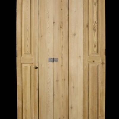 A pair of antique pine window shutters