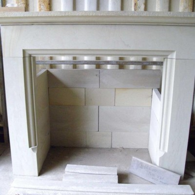 Stone smooth face fire surround and back