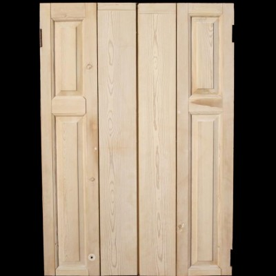 A pair of reclaimed pine window shutters