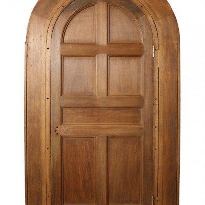 An arched oak door with frame C. 1897