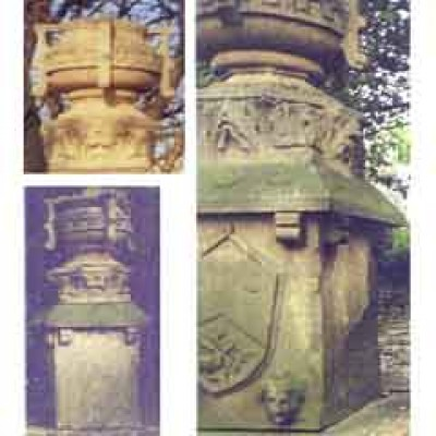 Four carved stone urns and plinths