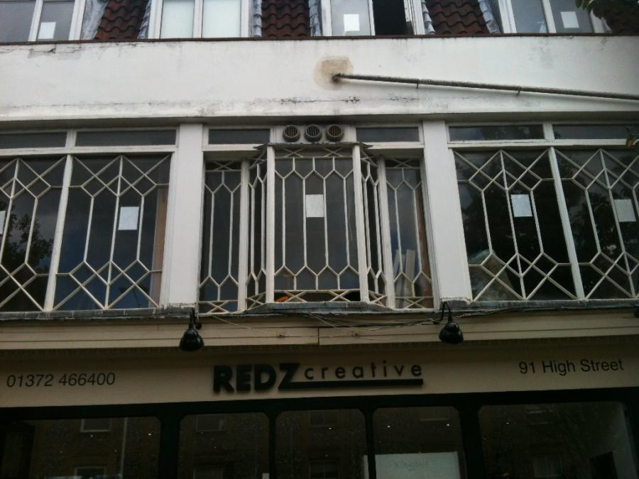 Large Victorian Windows with geometric panels