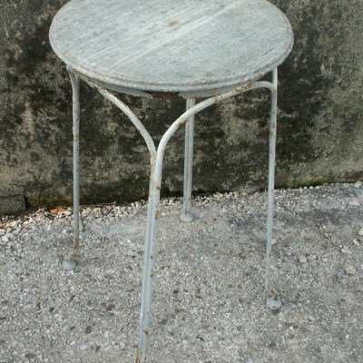 Iron and brass table with stone top