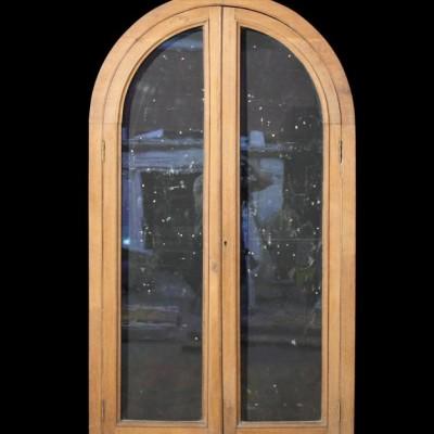 A glazed oak cupboard / alcove front
