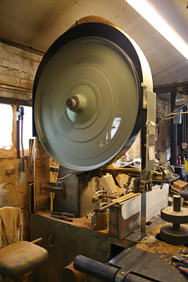 1509230374-Above-After-denailing-the-beams-are-steam-cleaned-and-then-sawn-into-sections-using-the-1946-T-Robinson-Son-band-resaw-run-hydraulically-using-an-adapted-Ford-Cargo-six-litre-petrol-engine--3.jpg