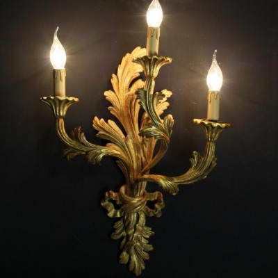 A set of four Italian carved and gilded wooden wall lights