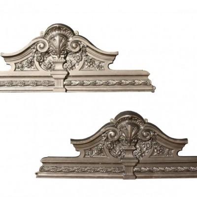 A pair of Victorian cast iron over door pediments