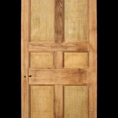 A hardwood six panel front door