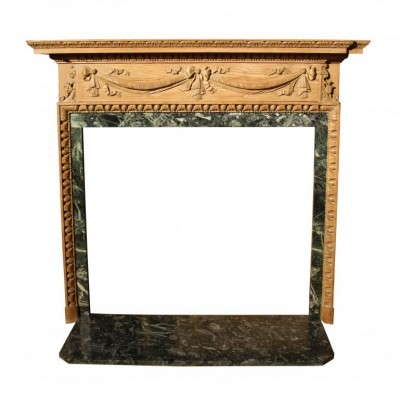 An early 19th C. carved pine fire surround with marble slips