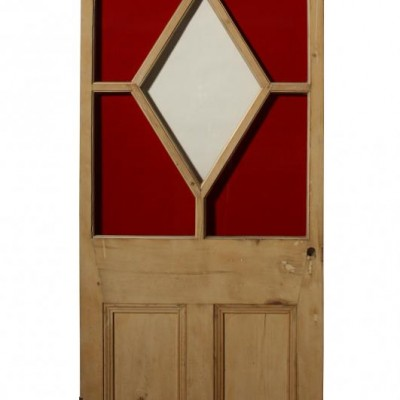 An antique stained glass pine door