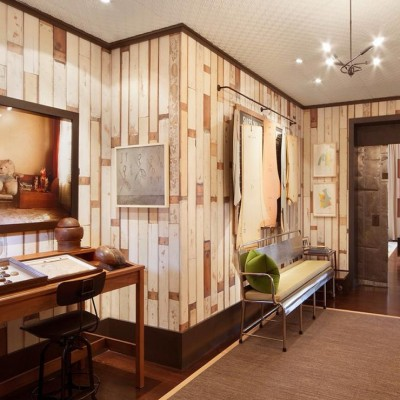 Mickey Drexler's Tribeca apartment with reclaimed pine wall cladding in original paint [photo © AD