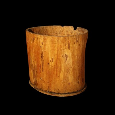 A reclaimed log basket formed from a large hollowed tree trunk