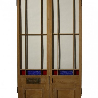 A pair of antique stained glass exterior double doors