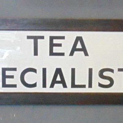 1920's Milk Glass Tea Specialist Advertising Sign