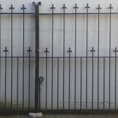 Victorian wrought iron driveway gates with matching pedestrian gate.
