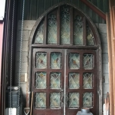 large arched pair of stain glass doors