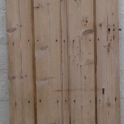 Early C19th beaded ledged pine door with elm ledges