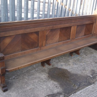 Carved oak pews