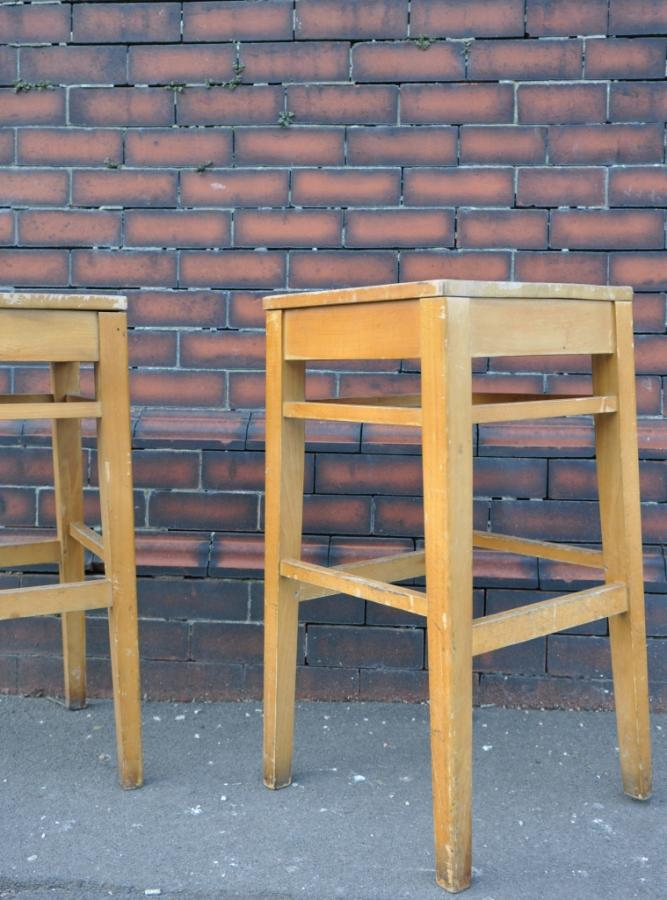 pair of oversize vintage school bar stools