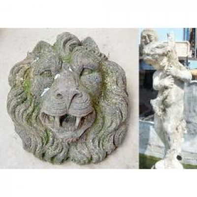 Stone lion head and lead boy with fish