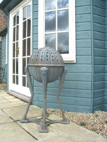Cast iron brazier and two fluted staddle stones