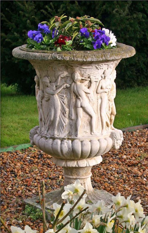 Carved stone garden urns (pair)