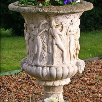 Carved stone garden urns (pair)