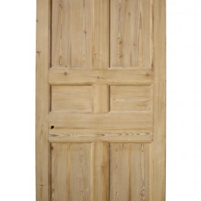 An antique stripped pine six panel door